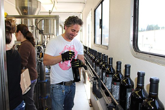 Applying labels to wine bottles
