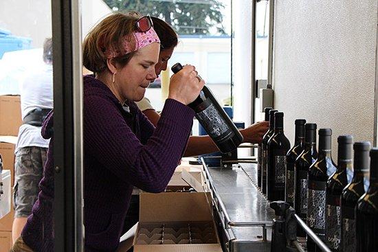 Packimng wine bottles in the mobile bottling truck
