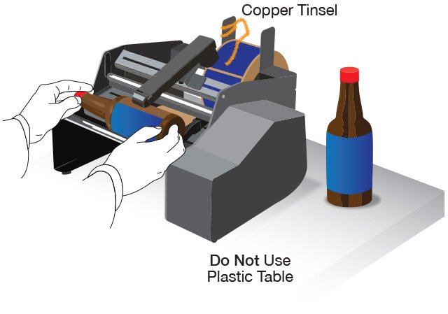 Hot to stop static on a label machine