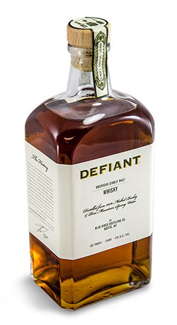 Defiant Whiskey label on bottle with cork label